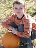 Lucas contemplating his choice of pumpkin.<br /> October 28, 2006