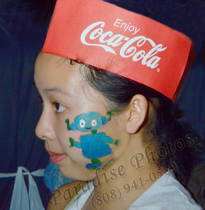 NAME?  Please email name to LamAssoc3@aol.com or  ParadisePhotos808@gmail.com   Coke hat and painted face - Punahou Carnival worker 020312