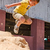 With all of the amusement rides and the animals to see, Dustin Gilbert, Jr., 5, has the most fun jumping on a dirt pile behind the livestock barns. Fran Ruchalski/Palatka Daily News