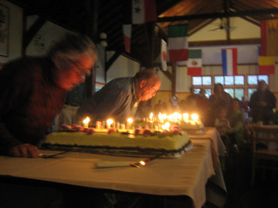 Addison Cate '39 (center) blowing out candles