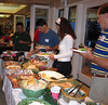 Joe Patoskie (blue shirt), Rami Ring, & Michael Mulvany fill up on all the good food.