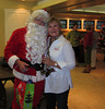 Santa (Jody Bright) greets Christine Barggren, one of the decorators.<br /> Carl McKinney chats with parents Jane & Steve in the background.  He's visiting from San Diego for the holidays.