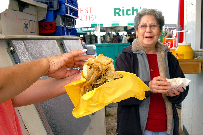 Elaine proudly displaying her hambuger piled high with onions!