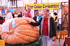 Mom standing next to a gigantic pumpkin!