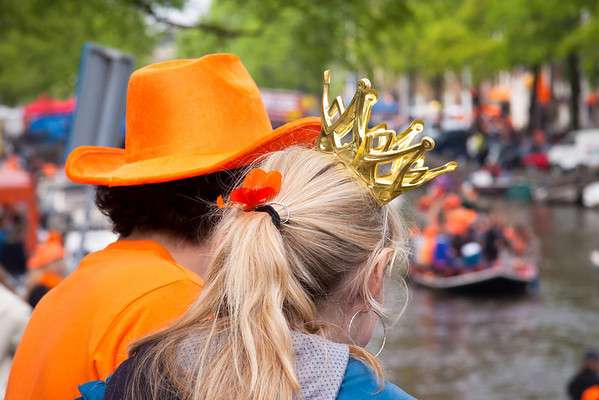 "Queen's Day | Amsterdam | 2010  April 30th is the Dutch National Holiday and the official birthday of their Queen.   The canal belt of Amsterdam is teeming with people wearing orange, selling all manner of stuff on the freemarket or partying in the street and on the  canals. They start the night before and since this year fell on a Friday they partied later than usual.  See more photos <a href=""/gallery/12027168_4Qd5k#853377837_s7QGt"">here</a>"