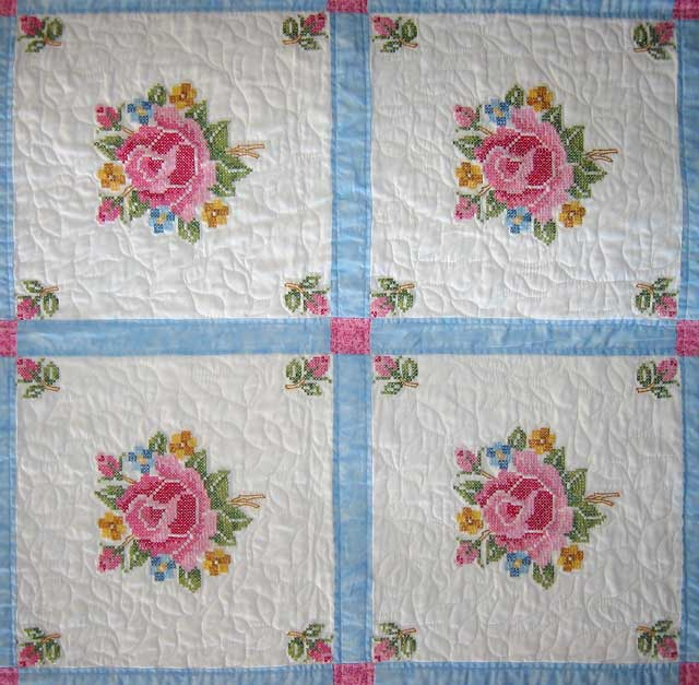 The roses in this quilt are cross stiched.