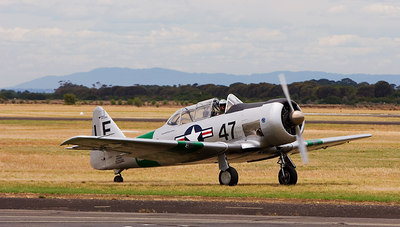 Pilot Mike FALLS Snr, landing the HARVARD 111 at Point Cook - RAAF Museum - Australia