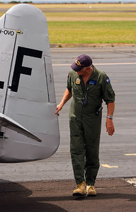 Pilot - Mike FALLS Snr doing a pre flight check  RAAF Museum - Point Cook