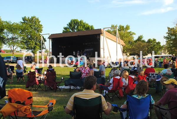A crowd enjoys music from the Slough Boys on Friday night during Finally Friday at the Riverview Bandshell. Nearly 1,000 RAGBRAI riders who had already staked their camping spot by 7:30 p.m. also listened to the music from their campsites in Riverview Park. • Katie Dahlstrom/Clinton Herald