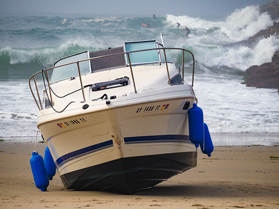 A boat washed up on Big Corona Beach...surfers were not bothered.