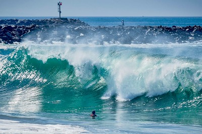 July 3, high tides provided great surfing opportunities at the Wedge