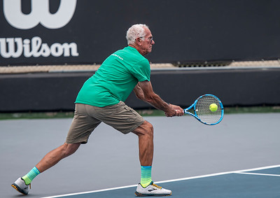 Even geezers minus their cameras can smack the ball.