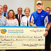 Debbie Blank | The Herald-Tribune<br /> Laughery Valley Fish & Game, represented by Brian Smith, will use the $2,500 check to buy gravel for a driveway to access fishing at a pond.
