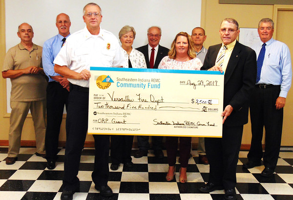 Debbie Blank | The Herald-Tribune<br /> The Versailles Fire Department, represented by Ben Sieverding, will use the $2,500 check to purchase an automated external defibrillator.