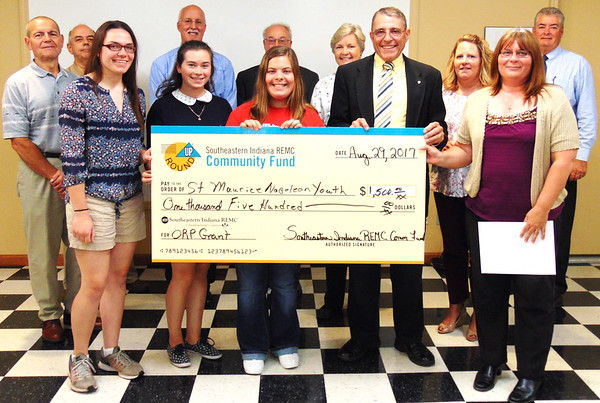 Debbie Blank | The Herald-Tribune<br /> St. Maurice Catholic Church, Napoleon, teens and an organizer accepted $1,500 from the not-for-profit electric cooperative that will enable 21 youth to go to a convention.