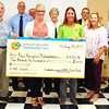 Debbie Blank | The Herald-Tribune<br /> Plants, groceries and garden supplies will be purchased thanks to the REMC $2,500 grant to New Horizons Rehabilitation, Batesville, represented by Brandy Bittner (from check center to right) and Stephanie Brown.