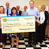 Debbie Blank | The Herald-Tribune<br /> Oldenburg Academy President Diane Laake (in blue) and assistant principal Jonathon Maple (to her left) are happy to get a $2,500 grant from REMC leaders. They are (from left) trustees Jerry Lamb and Carla Elston, general manager Keith Mathews, trustees Keith Allhands, Steve Black, Judy Copeland and Owen Menchhofer and office manager Barry Lauber.