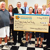 Debbie Blank | The Herald-Tribune<br /> Ripley County Food Pantry President Bill Warren (from left holding check), volunteers Sue Tunney and Lois Lunsford and Shelby Township trustee Phillip Morgan will use the $1,000 grant to purchase food for the needy.