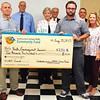 Debbie Blank | The Herald-Tribune<br /> The Youth Encouragement Services James B. Wismann Youth Home, Aurora, represented by program coordinator and case manager Jarrid Hornsby (holding check's right edge), received $2,500.