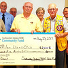Debbie Blank | The Herald-Tribune<br /> The Milan Lions Club, represented by Jerry Smith (from center of check to right) and Gene Pitts, will use its $2,500 grant to replace the town's Christmas decorations.