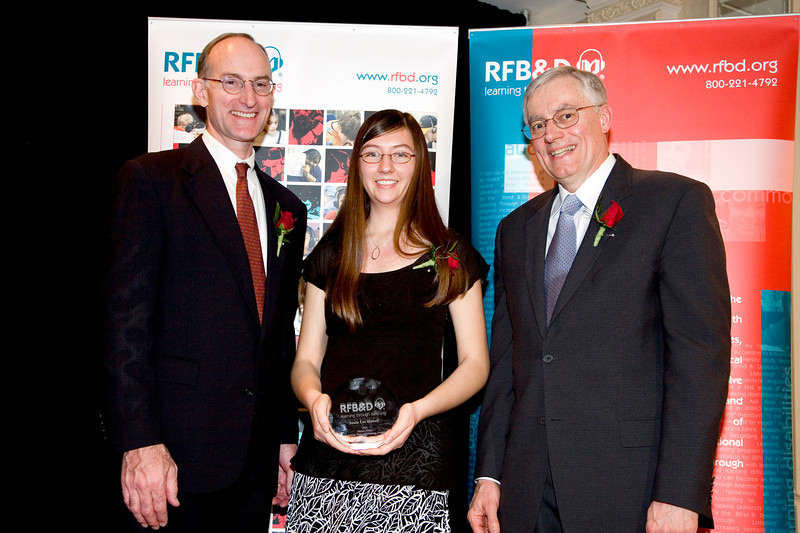 "WHEATON COLLEGE STUDENT HONORED AS 2006 NATIONAL ACHIEVEMENT AWARD WINNER BY RECORDING FOR THE BLIND & DYSLEXIC®<br /> <br /> Cincinnati, OH, resident to be recognized at national nonprofit's awards celebration in New York City<br /> <br /> February 5, 2007 (Princeton, NJ) ""Brilliant yet humble"" is how one of Junia Howell's teachers describe the nearly straight A graduate of Clark Montessori High School. Refusing to see her dyslexia as a disability, Howell earned the school's Human Relations Award in 2005 and has now been selected by Recording for the Blind & Dyslexic (RFB&D®) as one of three top winners of the 2006 Marion Huber Learning Through Listening® (LTL®) awards due to her extraordinary scholarship, leadership, enterprise and service to others. RFB&D is the nation's educational library of recorded textbooks for students with visual impairment, learning disabilities or other physical disabilities that make reading standard textbooks difficult or impossible.<br /> <br /> Howell credits RFB&D's audiobooks with allowing her to fully participate in literary analysis and explore her intellectual curiosity. <br /> <br /> ""Although it may seem cliche, the only reason I do as well as I do is because I am able to listen to my books,"" says the Cincinnati resident. Beyond academics, Howell is deeply involved in helping other young people as a community peer leader, tutor and participant in an urban after-school program. After graduating from Wheaton College, Howell wants to head to Africa, perhaps to teach or build, but definitely to continue making a difference in the lives of others.<br /> <br /> ""Although I love to learn, enjoy solving math and relax when swimming, the thing that makes me keep going is the opportunity to share a little bit of love and a lot of hope,"" she says.<br /> <br /> RFB&D's National Achievement Awards (NAA) include the Mary P. Oenslager Scholastic Achievement Awards (SAAs) for college seniors who are blind or visually impaired and the Marion Huber Learning Through Listening awards for high school seniors with learning disabilities. In all, RFB&D bestows more than $50,000 in awards to deserving students each year. RFB&D will recognize Howell and the other winners at its NAA event held in New York City on April 12, 2007. <br /> <br /> ""RFB&D's National Achievement Awards recognize the accomplishments of students who are outstanding role models, not only for people with disabilities, but for all of us who endeavor to reach our full potential as students and as citizens,"" says John Kelly, RFB&D President & CEO.<br /> <br /> RFB&D serves more than 146,000 students from kindergarten through graduate school and beyond, including more than 4,700 in Ohio, with its one-of-a-kind collection of educational titles on CD. RFB&D's AudioPlus® digitally recorded textbooks on CD provide unprecedented navigation, ease of use and proven effectiveness as learning tools for students with print disabilities. Students rely on RFB&D's unique accommodation to access the printed page and to achieve educational success. All of RFB&D's accessible titles are recorded by volunteers working in 29 recording studios nationwide.<br /> <br /> For information on RFB&D, volunteering or making a donation, call toll-free 866-RFBD-585 (866-732-3585) or visit RFB&D's accessible website at  <a href=""http://www.rfbd.org"">http://www.rfbd.org</a>.<br /> <br /> Photo caption: (left to right) RFB&D President & CEO John Kelly; LTL Winner Junia Howell; RFB&D National Board Chair Richard V. Cox.<br /> <br /> <br /> EDITORS NOTE:  Interview opportunities are available by calling Mark Zustovich at 609-520-7993, or after hours at 609-610-4508.<br /> # # #"