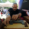 "Felix Rodriguez, of The Cigar Agency, makes cigars during the festival.<br /> The 1st Annual Rocky Mountain Cigar Festival was held at the Millennium Harvest House gardens on Sunday.<br />  For more photos of the festival, go to  <a href=""http://www.dailycamera.com"">http://www.dailycamera.com</a>.<br /> Cliff Grassmick / August 29, 2010"