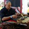 "Felix Rodriguez, of The Cigar Agency, wraps cigars during the festival.<br /> The 1st Annual Rocky Mountain Cigar Festival was held at the Millennium Harvest House gardens on Sunday.<br />  For more photos of the festival, go to  <a href=""http://www.dailycamera.com"">http://www.dailycamera.com</a>.<br /> Cliff Grassmick / August 29, 2010"