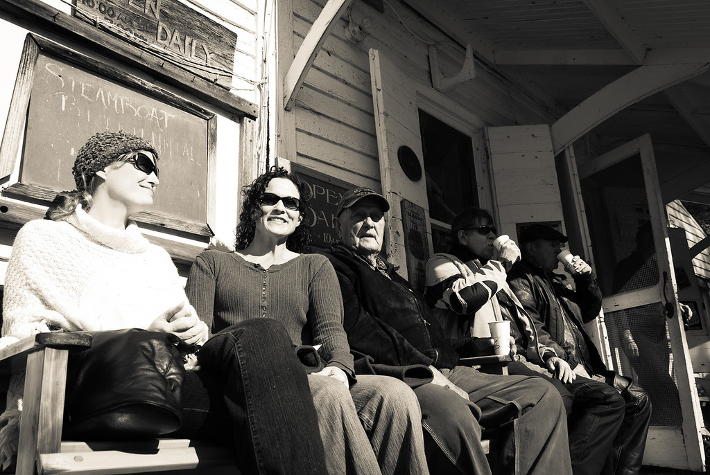 Setting on the porch at the General Store during the Rabbit Hash Steamboat Bicentennial Celebration.