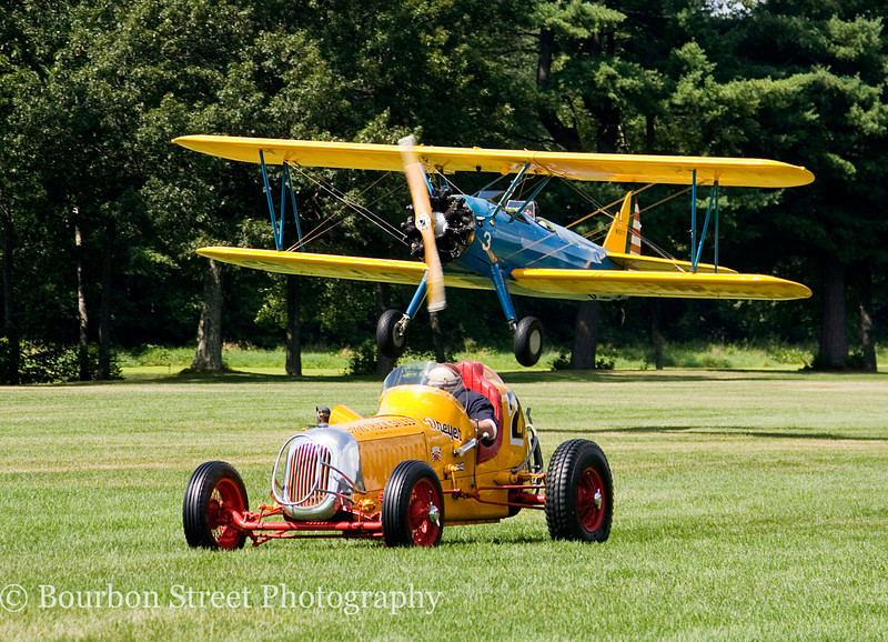 First lap - PT-17 Stearman Bi-Plane vs. 1930's Sprint Car