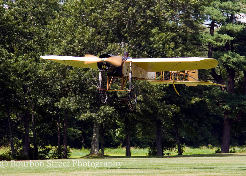 1909 Bleriot Type XI in mid-race against a 1914 Stutz Bearcat