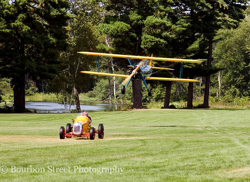 Heading for the finish line - PT-17 Stearman Bi-Plane vs. 1930's Sprint Car