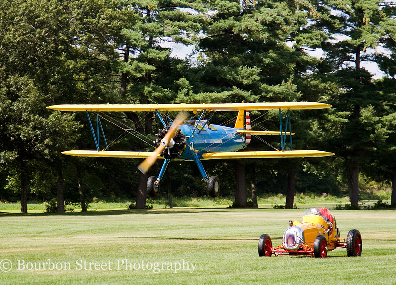 At the finish line - PT-17 Stearman Bi-Plane vs. 1930's Sprint Car