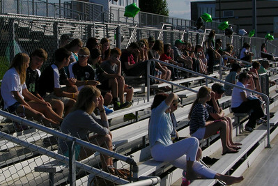 The crowd enjoys the alumni soccer game at Raiderfest 2013 at Twin Valley High School Aug. 24.