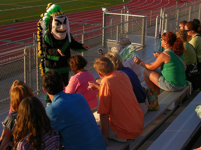 The Chief passes out freebees to the crowd at Raiderfest 2013 at Twin Valley High School Aug. 24.