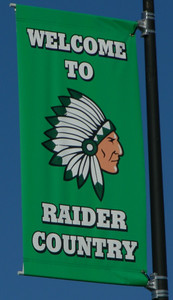 "These ""Welcome to Raider Country"" flags, on display at Raiderfest 2013, were purchased with funds raised at last year's event."