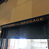 "Ashleigh Fox | The Sheridan Press<br /> The ""Express Baggage"" window in the railroad station on Broadway Street in Sheridan Thursday, March 15, 2018. California and Sheridan resident Tom Thompson and his wife purchased the building and are restoring it back to its original charm."
