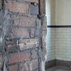 Ashleigh Fox | The Sheridan Press<br /> Exposed Tiffany brick in a previous door opening in the railroad station on Broadway Street in Sheridan Thursday, March 15, 2018. California and Sheridan resident Tom Thompson and his wife purchased the building and are restoring it back to its original charm.