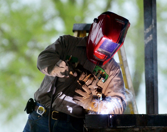 WARREN DILLAWAY | Star Beacon<br /> Kelly's Welding and Fabricating work at the Conneaut Township Park lower pavilion on Monday afternoon.