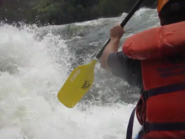 """Surfing"" white water style!  If you paddle like crazy into a small waterfall, you can get the raft ""stuck"" between the pull of the water rushing down to the bottom and the push of the water going down river.  The raft before us capsized while surfing and it looked a little scary for a minute."
