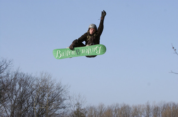 Record-Eagle/Garret Leiva<br /> Caleb Gerhard grabs his board in midair Saturday at the Rare Air Fest at Mt. Holiday in Traverse City. The daylong concert and big air competition featured dozens of snowboarders and skiers launching off six-foot jumps with 20-foot drops, as they twisted through the air to the sounds of six live bands.