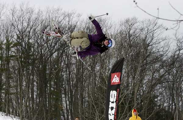 Record-Eagle/Garret Leiva<br /> Ryan Haworth flips high above the slopes Saturday at the Rare Air Fest at Mt. Holiday in Traverse City. The daylong concert and big air competition featured dozens of snowboarders and skiers launching off six-foot jumps with 20-foot drops, as they twisted through the air to the sounds of six live bands.