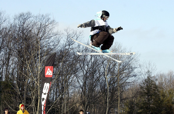 Record-Eagle/Garret Leiva<br /> Reese Spaulding crosses his skis as he spins high above the crowd Saturday at the Rare Air Fest at Mt. Holiday in Traverse City. The daylong concert and big air competition featured dozens of snowboarders and skiers launching off the jumps with 20-foot drops, as they twisted through the air to the sounds of six live bands.