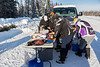 People from Fort Albany and others wait and prepare a meal for the walkers along the road.