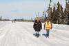 Walkers along the road north of Moosonee.