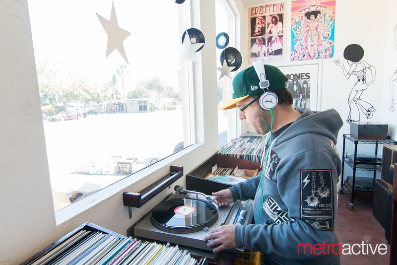 Patron listening to some of available records