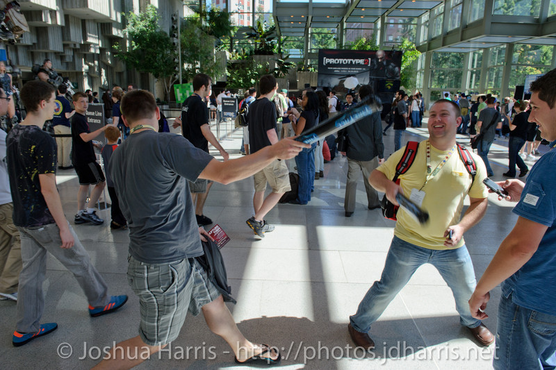 Fans having a sword fight with the Firefall thunder sticks