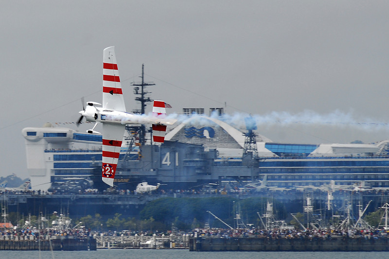He flies past the Midway Museum and the Princess Cruiselines' ship.