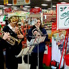 The Salvation Army of New Castle kicked off its 2015 Red Kettle Campaign on Saturday at Shop 'N Save in Westgate Plaza. Playing Christmas carols to help set the stage were, from left, Cynthia Bayle, Oonagh Henning and Salvation Army Capt. Kiley Williams.