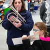 Sydney Williams holds the music while her mom, Capt. Kiley Williams, plays.