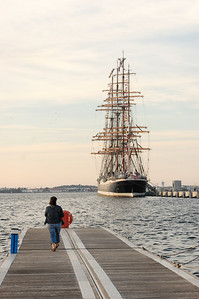 """Sedov The four masted sail training barque of the University of Murmansk, Sedov, is the vessel on which the young cadets of the university train to become officers, mechanics and radio specialists. Sedov can accommodate up to 320 people on board among which 75 are crew members, 100 to 120 cadets and in some years, as many as 45 trainees of any nationality to discover life aboard a tall ship. This training takes place during a journey of 3 to 4 months along European coasts and will take advantage of cultural and economic exchanges with the ports. Launched in Kiel in 1921 at the shipbuilding yard Krupp, Sedov (then named Magdalene Vinnen) with an auxiliary diesel engine with some 128hp, was exclusively dedicated to the transport of goods and the crew were already partially made up of cadets. In 1936, Magdalene Vinnen was sold to Norddeutscher Lloyd, Bremen and was renamed Kommodore Johnsen. She carried out numerous circumnavigations, transporting some wheat, some coal and some cereals. The Second World War put an end to these journeys as an ocean-going vessel, but she continued to train cadets in the Baltic where her journeys lasted from 5 to 6 weeks. During this time of scarcity of fuel, she would sail only. She came under Russian state ownership after the surrender of Germany. The four masted barque was then renamed """"Sedov"""" after the polar explorer Georgij Sedov who died during an investigation in the Arctic in 1914. Sedov navigated as an oceanographical vessel until 1966, she was then put in reserve to Kronstadt and she reappeared in the 1970's. Between the 1970's and 1981 various works were carried out which cost in the region of 1 million roubles. She left the shipyard in 1981 and, with Riga as the port of registry, she embarked henceforth cadets from schools of navigation of Kalingrad and Murmansk. The fall of the Wall in 1989 and the Proclamation of Independence of Latvia in 1991 influenced the fate of Sedov. Living in the lap of Russia, she left Riga for Murma"""